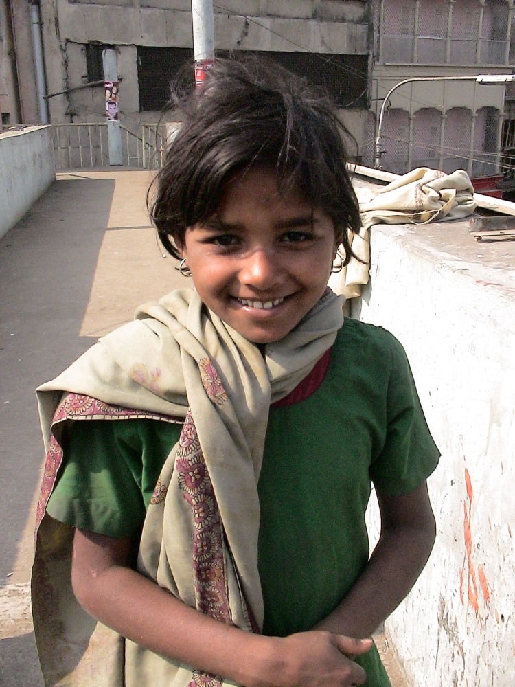 Poor girl near a slum